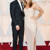 Justin Theroux u odelu Dolce & Gabbana, i Jennifer Aniston, u haljini Atelier Versace