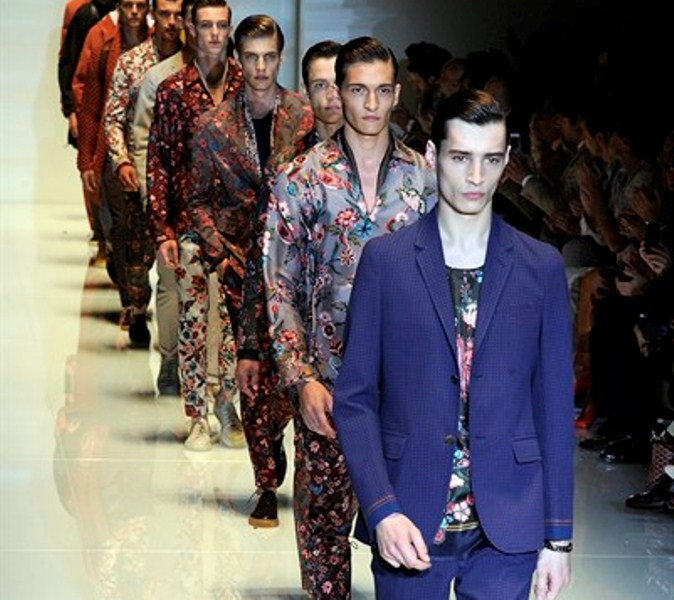 Models take the catwalk for the final exit at the Gucci men's Spring-Summer 2014 collection, part of the Milan Fashion Week, unveiled in Milan, Italy, Monday, June 24, 2013. (AP Photo/Giuseppe Aresu)