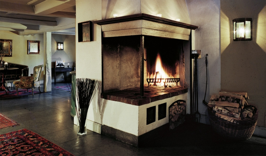 Stallmastaregarden fireplace in lobby